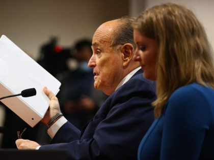 LANSING, MI - DECEMBER 02: U.S. President Donald Trump's personal attorney Rudy Giuliani speaks as Jenna Ellis, a member of the president's legal team looks on, at an appearance before the Michigan House Oversight Committee on December 2, 2020 in Lansing, Michigan. Guiliani and the president's legal team are claiming …