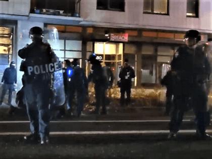 ICE officers make an arrest outside their Portland, Oregon, facility. (Twitter Video Screenshot/Justin Yau)