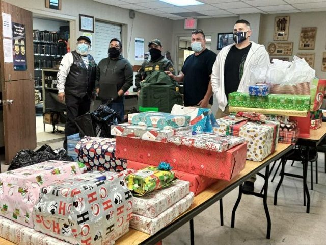 Border Patrol agents from the Fallen Agents Fund prepare to deliver Christmas presents to the families of fallen Border Patrol agents. (Photo: The Fallen Agents Fund)