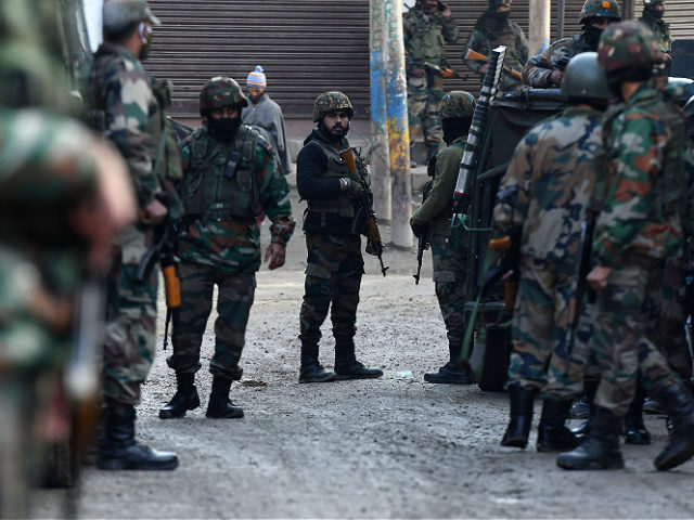 Indian army soldiers stand guard near the site of a shootout where two soldiers were allegedly killed by the suspected militants on the outskirts of Srinagar on November 26, 2020. (Photo by TAUSEEF MUSTAFA / AFP) (Photo by TAUSEEF MUSTAFA/AFP via Getty Images)