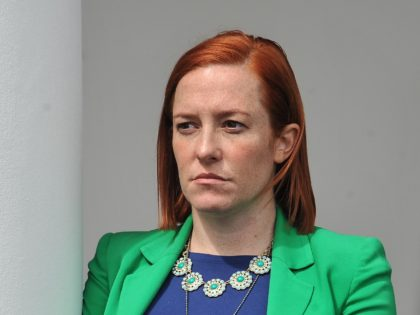 White House Communications Director Jen Psaki listens to US President Barack Obama makes a statement at the White House in Washington, DC, on April 2, 2015 after a deal was reached on Iran's nuclear program. Iran and world powers agreed on the framework of a potentially historic deal aimed at …