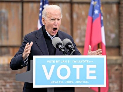 ATLANTA, GA - DECEMBER 15: U.S. President-elect Joe Biden speaks during a drive-in rally for U.S. Senate candidates Jon Ossoff and Rev. Raphael Warnock at Pullman Yard on December 15, 2020 in Atlanta, Georgia. Biden's stop in Georgia comes less than a month before the January 5 runoff election for …