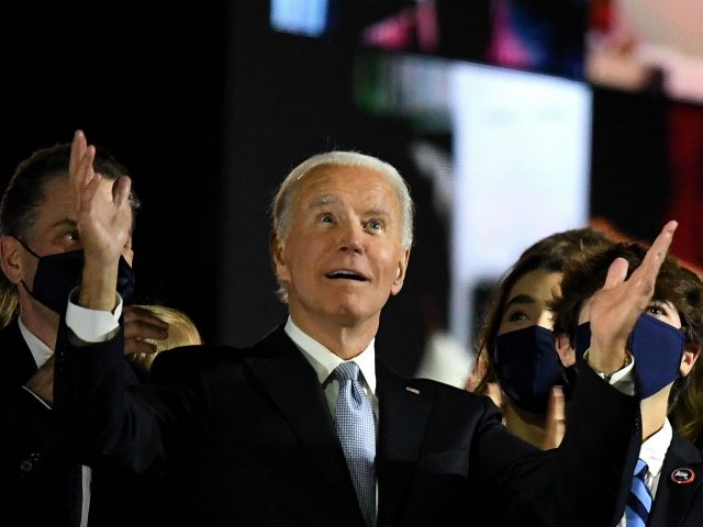 US President-elect Joe Biden with his wife Jill Biden, alongside family members, salute the crowd on stage after delivering remarks in Wilmington, Delaware, on November 7, 2020, and being declared the winner of the US presidential election. (Photo by Roberto SCHMIDT / AFP) (Photo by ROBERTO SCHMIDT/AFP via Getty Images)
