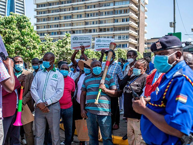 Nurses and Clinical Officers gather in front of Kenya´s Parliament during a march in Nairobi on December 14, 2020. Nurses and Clinical Officers went on strike on December 07, 2020 demanding safer working conditions after more than 60 health workers died of COVID-19 coronavirus since the beginning on the pandemic. …