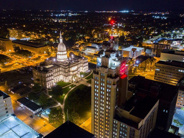 The state of Michigan, city of Lansing downtown landscape at night.