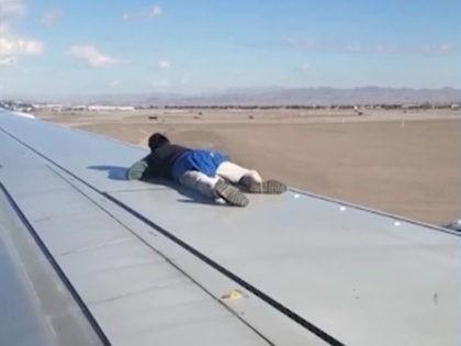 Man on plane wing