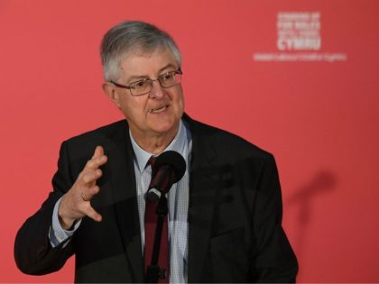 Welsh Labour leader Mark Drakeford speaks at a rally as Britain's opposition Labour party leader Jeremy Corbyn campaigns for the general election in Swansea, south Wales on December 7, 2019. - Britain will go to the polls on December 12, 2019 to vote in a pre-Christmas general election. (Photo by …