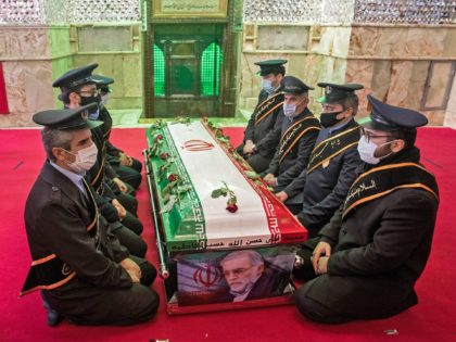 "OPSHOT - Members of Iranian forces pray around the coffin of slain nuclear scientist Mohsen Fakhrizadeh during the burial ceremony at Imamzadeh Saleh shrine in northern Tehran, on November 30, 2020. - Iran said Israel and an exiled opposition group used new and ""complex"" methods to assassinate its leading nuclear …"
