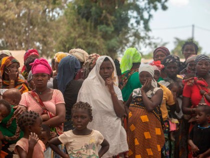 TOPSHOT - Displaced women attend a meeting on December 11, 2020 at the Centro Agrrio de Napala where hundreds of displaced arrived in recent months are sheltered, fleeing attacks by armed insurgents in different areas of the province of Cabo Delgado, in northern Mozambique. (Photo by Alfredo Zuniga / AFP) …