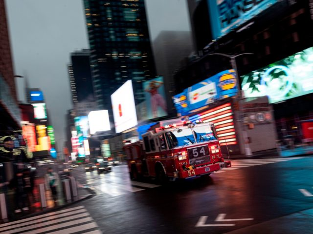 A firefighter truck drives through the almost deserted Times Square amid the Covid-19 pandemic on April 30, 2020 in New York City. (Photo by Johannes EISELE / AFP) (Photo by JOHANNES EISELE/AFP via Getty Images)
