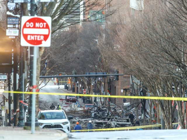 NASHVILLE, TENNESSEE - DECEMBER 25: Police close off an area damaged by an explosion on Christmas morning on December 25, 2020 in Nashville, Tennessee. A Hazardous Devices Unit was en route to check on a recreational vehicle which then exploded, extensively damaging some nearby buildings. According to reports, the police …