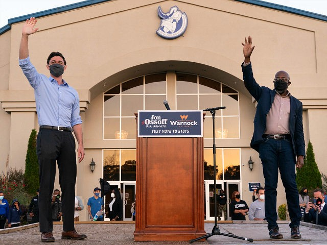 JONESBORO, GA - NOVEMBER 19: Democratic U.S. Senate candidates Raphael Warnock and Jon Ossoff are seen at a campaign event on November 19, 2020 in Jonesboro, Georgia. Democratic U.S. Senate candidates Raphael Warnock and Jon Ossoff are campaigning in the state ahead of their January 5 runoff races against Sen. …