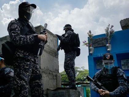 MANILA, PHILIPPINES - OCTOBER 16: Armed jail guards and police secure the perimiter of a local cemetary where Reina Mae NAsino, a detained human rights activist will attend the burial of her three month old daughter on October 16, 2020 in Manila, Philippines. 23-year-old human rights activist Reina Mae Nasino …