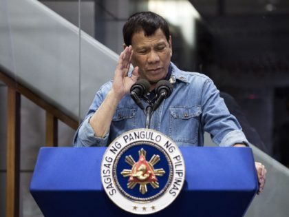 "Philippine's President Rodrigo Duterte delivers his speech to overseas Filipino workers (OFW) that arrived in Manila from Kuwait are at the Manila International Airport on February 13, 2018. Kuwait's foreign minister on February 13 condemned what he called an ""escalation"" by Manila after the Philippines expanded a ban on its …"