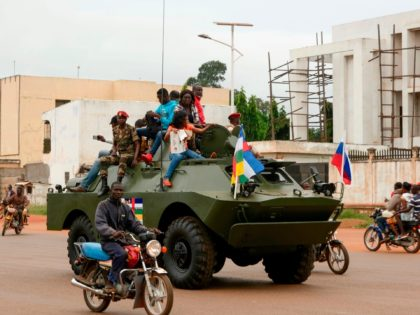 A Russian armoured personnel carrier (APC) is seen driving in the street during the delivery of armoured vehicles to the Central African Republic army in Bangui, Central African Republic, on October 15, 2020. (Photo by Camille Laffont / AFP) (Photo by CAMILLE LAFFONT/AFP via Getty Images)