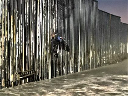 Border Patrol agents rescue a Mexican national after he became stuck on the border wall. Photo: U.S. Border Patrol/San Diego Sector. (Photo: U.S. Border Patrol/San Diego Sector)