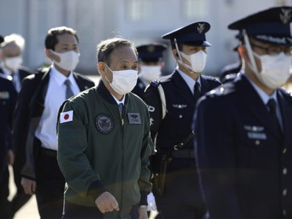 Japanese Prime Minister Yoshihide Suga attends an inpection as he reviews the Japan Air Self-Defense Force at the Air Self-Defense Force's Iruma base in Sayama, Saitama Prefecture on November 28, 2020. (Photo by David MAREUIL / POOL / AFP) (Photo by DAVID MAREUIL/POOL/AFP via Getty Images)