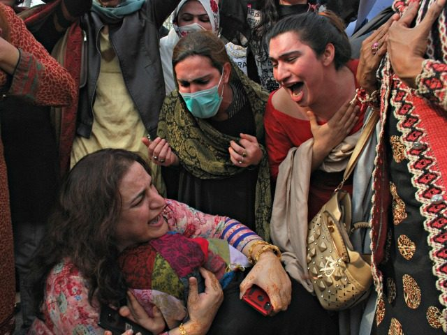 Members of the Pakistani transgender community console each other during a rally in Peshawar, Pakistan, Thursday, Feb. 20, 2020. The rally was organized against an alleged harassment and violence by local police against transgender community. (AP Photo/Muhammad Sajjad)