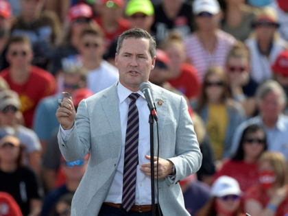 In this Friday, Oct. 16, 2020 file photo, Rep. Michael Waltz, R-Fla., speaks before President Donald Trump during a campaign rally at the Ocala International Airport in Ocala, Fla. A Florida newspaper apologized Friday, Dec. 11, 2020 for endorsing the re-election of a Republican congressman who now supports a lawsuit …