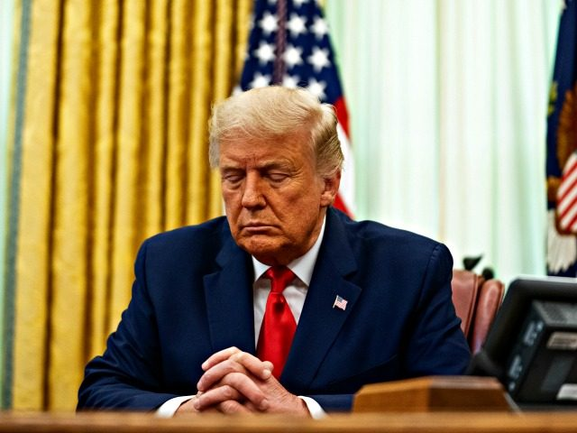 WASHINGTON, DC - AUGUST 28: U.S. President Donald Trump participates in a prayer during an event in the Oval Office of the White House August 28, 2020 in Washington, DC. President Trump has officially pardoned former federal prisoner Alice Johnson, who was sentenced to life for cocaine trafficking in 1997 …