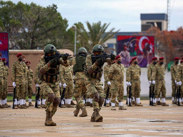 Libyan military graduates loyal to the UN-recognised Government of National Accord (GNA) perform manoeuvers during a parade marking their graduation, a result of a military training agreement with Turkey, at the Omar Mukhtar camp in the city of Tajoura, southeast of the capital Tripoli on November 21, 2020. (Photo by …