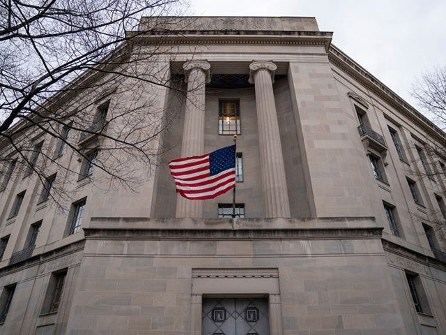 WASHINGTON, DC - FEBRUARY 19: The Department of Justice headquarters stands on February 19, 2020 in Washington, DC. A Department of Justice spokesperson is denying that Attorney General William Barr is considering resigning after his critical comments about President Trump Trump tweeting about ongoing Department of Justice cases. (Photo by …