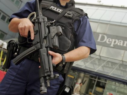 "LONDON - AUGUST 11: An armed British police officer patrols outside of Heathrow Airport on August 11, 2006 in London, England. The UK security threat level is to stay at ""critical"" as police continue to question 24 suspects following a suspected plot to blow up several aeroplanes was uncovered. (Photo …"