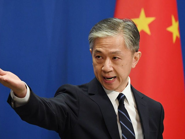 Chinese Foreign Ministry spokesman Wang Wenbin takes a question during the daily Foreign Ministry briefing in Beijing on July 24, 2020. - China on July 24 ordered the US consulate in the southwestern city of Chengdu to close in retaliation for one of its missions in the United States being …