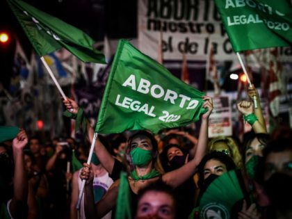 BUENOS AIRES, ARGENTINA - DECEMBER 30: Pro-choice demonstrators wait for the result of vote on December 30, 2020 in Buenos Aires, Argentina. The proposal authorizes legal, voluntary and free interruption of pregnancy until the 14th week while allowing doctor's conscientious objection. It is the ninth bill to legalize abortion treated …