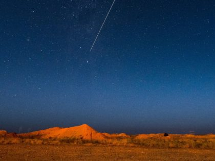 A long exposure shows the light trail of a re-entry capsule, carrying samples collected from a distant asteroid after being released by Japanese space probe Hayabusa-2, entering the Earth's atmosphere as seen from Coober Pedy in South Australia early on December 6, 2020. (Photo by Morgan Sette / AFP) (Photo …