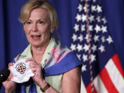 WASHINGTON, DC - JULY 08: White House coronavirus response coordinator Deborah Birx holds up a mask as she speaks during a White House Coronavirus Task Force press briefing at the U.S. Department of Education July 8, 2020 in Washington, DC. Vice President Pence and the task force members discussed the …