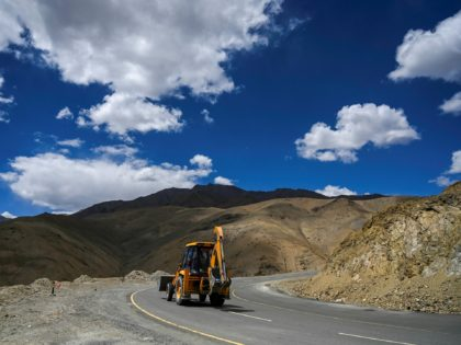 A man drives an excavator on the highway in Karakoram mountains connecting the Kashmir valley with Ladakh on June 21, 2020. - India and China agreed on June 17 to ease tensions at their disputed Himalayan border, even as they traded blame for a brawl that left at least 20 …