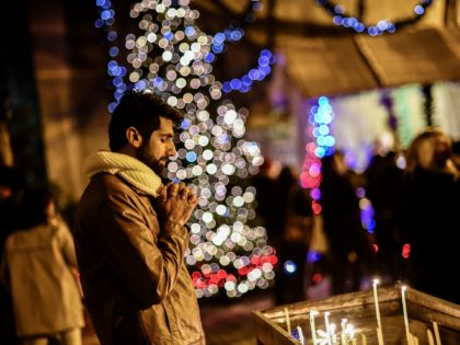 A man prays as he attends Christmas Mass at Saint Antuan Church in the Beyoglu district of Istanbul, on December 24, 2017. / AFP PHOTO / YASIN AKGUL (Photo credit should read YASIN AKGUL/AFP via Getty Images)