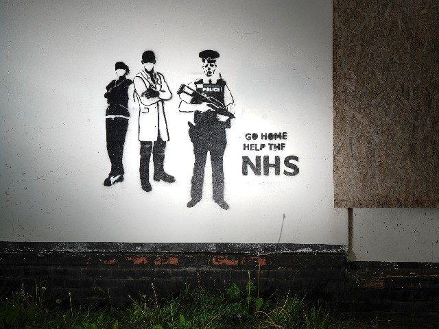 BURY, UNITED KINGDOM - MAY 18: Graffiti art declaring 'Go Home Help The NHS' adorns the wall of a derelict building on May 18, 2020 in Bury, United Kingdom. The British government has started easing the lockdown it imposed two months ago to curb the spread of Covid-19, abandoning its …