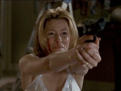 Elizabeth Banks and Michael Rooker in Slither (2006, Gold Circle Films)