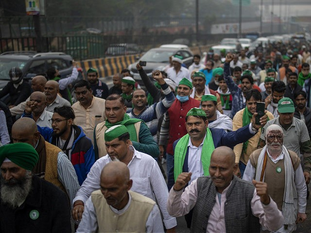 A group of protesting farmers march towards the residence of ruling Bhartiya Janata Party leader Mahesh Sharma to hand over a list of their demands during a protest against new farm in Noida on the outskirts of New Delhi, India, Saturday, Dec. 12, 2020. Indian farmers filed a petition with …