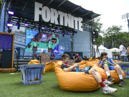 NEW YORK, NEW YORK - JULY 26: Fans attend day one of the Fortnite World Cup Finals at Arthur Ashe Stadium on July 26, 2019 in the Queens borough of New York City. (Photo by Sarah Stier/Getty Images)