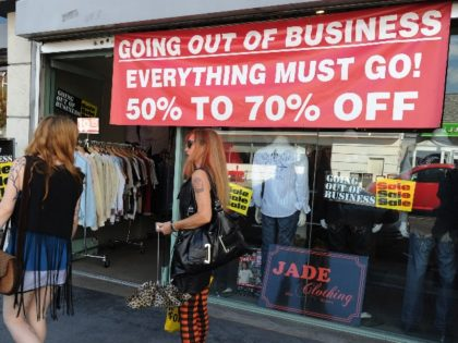 Shoppers walk past a clothing store going out of business in Los Angeles on September 28, 2010. US stocks faltered on Tuesday after a report showed US buyers' confidence dropped in September, sparking new fears over the recovery of the world's largest economy. The previous day's jittery trade continued after …