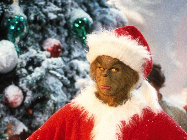 "381271 01: Jim Carrey Stars As The Grinch, The Green Monster Who Disguises Himself As Santa Claus And Burglarizes Every Single House In The Village Of Whoville On Christmas Eve In The Live-Action Adaptation Of The Famous Christmas Tale, ""Dr. Seuss' How The Grinch Stole Christmas,"" Directed By Ron Howard. …"