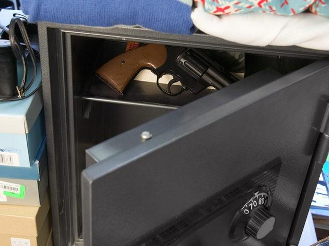 Gun inside open safe