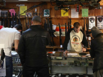 Customers shop for guns at Freddie Bear Sports sporting goods store on January 19, 2012 in Tinley Park, Illinois. (Photo by Scott Olson/Getty Images)