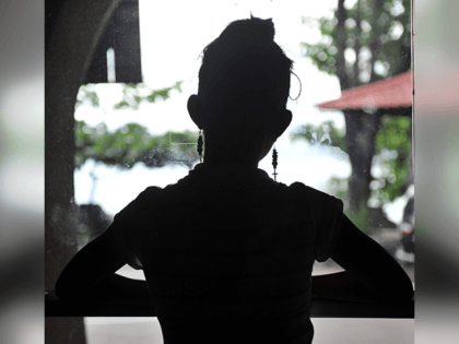 One of the five teenage girls rescued from a cyber sex den is sillhouetted in this photo taken at Preda Foundation office on December 2, 2010 in Olongapo City. Orders were streaming in when police barged in at a house in the northern Philippines, where naked girls manning computers acted …