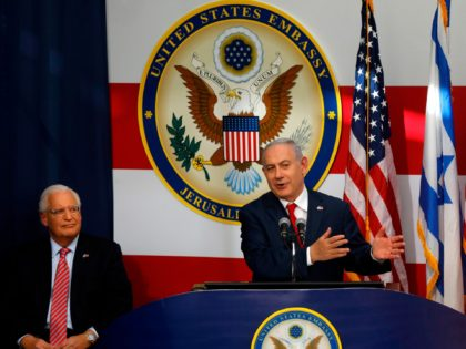 TOPSHOT - US ambassador to Israel David Friedman listens as Israel's Prime Minister Benjamin Netanyahu delivers a speech during the opening of the US embassy in Jerusalem on May 14, 2018. - The United States moved its embassy in Israel to Jerusalem after months of global outcry, Palestinian anger and …