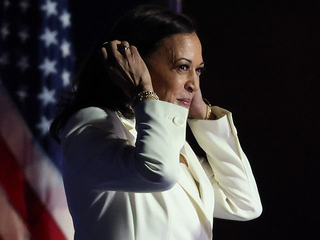 WILMINGTON, DELAWARE - NOVEMBER 07: Vice President-elect Kamala Harris takes the stage before President-elect Biden addresses the nation from the Chase Center November 07, 2020 in Wilmington, Delaware. After four days of counting the high volume of mail-in ballots in key battleground states due to the coronavirus pandemic, the race …