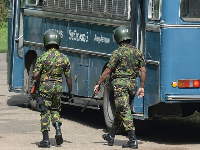 Special Task Force (STF) personnel deploy at Mahara prison on the outskirts of Colombo on November 30, 2020 a day after a prison riot over the surge of coronavirus infections. - Intermittent gunfire rang out on November 30 at a Sri Lankan high security prison where a riot by inmates …