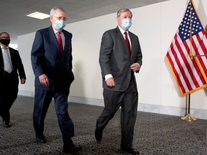 Senate Majority Leader Mitch McConnell of Ky., left, and Sen. Lindsey Graham, R-S.C., wear face masks to protect against the spread of the new coronavirus as they arrive for a weekly luncheon on Capitol Hill in Washington, Tuesday, May 19, 2020. (AP Photo/Patrick Semansky)