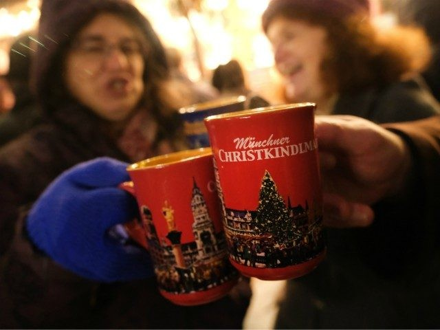 MUNICH, GERMANY - DECEMBER 13: Visitors drink mulled wine (Glühwein) at the annual Christmas at Marienplatz square on December 13, 2018 in Munich, Germany. Munich is currently in full Christmas mode with Christmas markets, decorations and shopping across the city. (Photo by Sean Gallup/Getty Images)