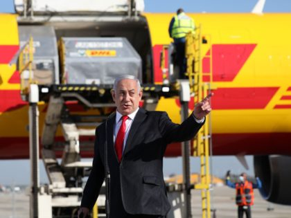 Israeli Prime Minister Benjamin Netanyahu gestures during a ceremony to mark the arrival of a plane of the international courier company DHL, carrying over 100,000 of doses of the first batch of Pfizer vaccines which landed at Ben Gurion Airport near Tel Aviv, on December 9, 2020. - According to …