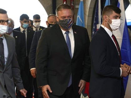 US Secretary of State Mike Pompeo (C) arrives for a tour of the Friends of Zion Museum on November 20, 2020, in Jerusalem. - US Secretary of State Mike Pompeo became the first top American diplomat to visit a West Bank Jewish settlement and the Golan Heights, cementing Donald Trump's …