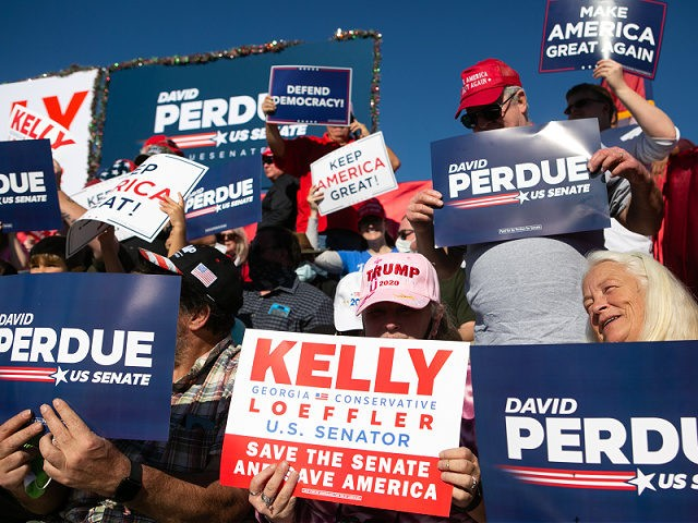 "AUGUSTA, GA - DECEMBER 10: Supporters hold signs and wait for the start of a rally with Vice President Mike Pence as he lends support for Sen. David Purdue (R-GA) and Sen. Kelly Loeffler (R-GA) on December 10, 2020 in Augusta, Georgia. The ""Defend the Majority"" rally comes ahead of …"